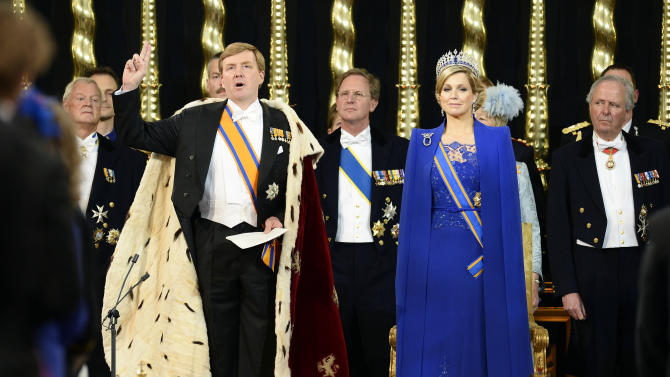 Dutch King Willem-Alexander takes the oath as his wife Queen Maxima stands at his side during his inauguration inside the Nieuwe Kerk or New Church in Amsterdam, The Netherlands, Tuesday April 30, 2013. Around a million people are expected to descend on the Dutch capital for a huge street party to celebrate the first new Dutch monarch in 33 years.   (AP Photo/Lex van Lieshout, Pool)
