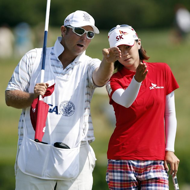 Na Yeon Choi, right, talks with her caddie on the 13th green during the third round of the U.S. Women's Open golf tournament on Saturday, July 7, 2012, in Kohler, Wis. (AP Photo/Jeffrey Phelps)
