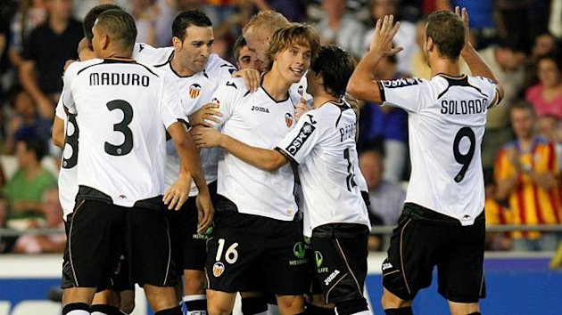 Valencia's players celebrate after Sergio Canales (16) scored against Granada during their Spanish first division match at the Mestalla Stadium
