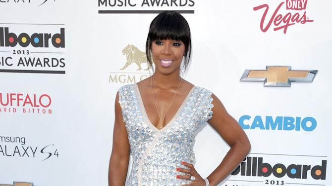 "FILE - This May 19, 2013 file photo shows singer Kelly Rowland at the Billboard Music Awards in Las Vegas. Simon Cowell has added former Destiny's Child singer Kelly Rowland and Latin artist Paulina Rubio to the cast of his competition show ""The X Factor."" Rowland and Rubio will be on the show when it starts its third season on Fox this fall. They replace Britney Spears and record producer Antonio ""L.A."" Reid. (Photo by John Shearer/Invision/AP, file)"