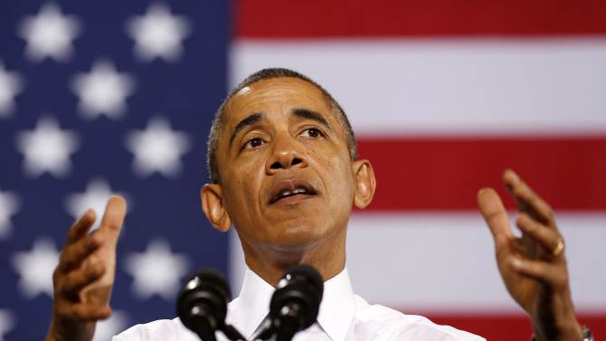 U.S. President Barack Obama addresses employees of General Electric's Waukesha Gas Engines facility in Wisconsin