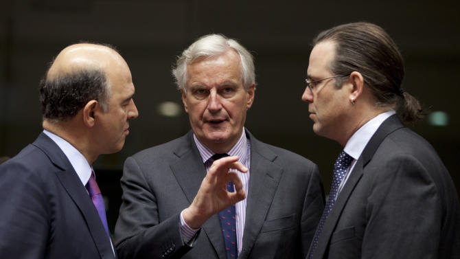 European Commissioner for Internal Market Michel Barnier, center, speaks with French Finance Minister Pierre Moscovici, left, and Sweden's Finance Minister Anders Borg during a meeting of EU finance ministers at the EU Council building in Brussels on Tuesday, Nov. 13, 2012. Shoring up Europe's banking sector and strengthening oversight of economic policies will likely top the agenda of a meeting Tuesday of the European Union's 27 finance ministers. (AP Photo/Virginia Mayo)
