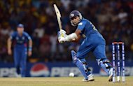 Sri Lankan cricketer Mahela Jayawardene plays a shot during the ICC Twenty20 Cricket World Cup's Super Eight match between England and Sri Lanka at the Pallekele International Cricket Stadium in Pallekele. Sri Lanka beat England by 19 runs to reach the World Twenty20 semi-finals along with West Indies Monday and send the defending champions crashing out of the tournament