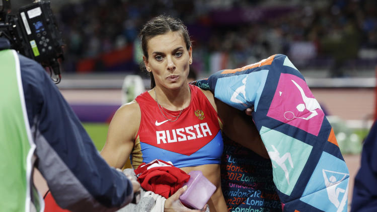 Russia's Yelena Isinbayeva reacts after winning bronze in the women's pole vault final during the athletics in the Olympic Stadium at the 2012 Summer Olympics, London, Monday, Aug. 6, 2012. (AP Photo/David J. Phillip)