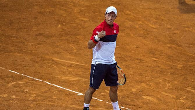 Kei Nishikori from Japan celebrates a point during his Madrid Open tennis tournament match against David Goffin from Belgium in Madrid, Spain, Thursday, May 7, 2015. (AP Photo/Andres Kudacki)