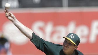 Parker, A's rout Rangers 11-4 to even up AL West
