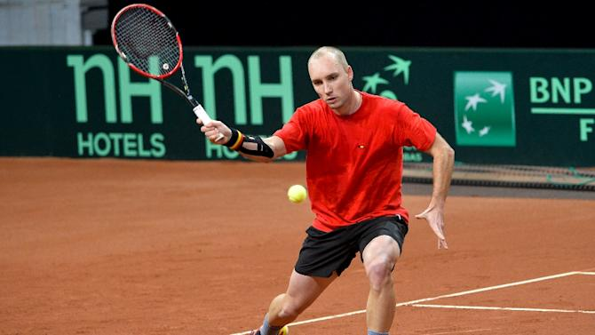Belgium's Steve Darcis takes part in a training session ahead of the Davis Cup World Group final between Belgium and Britain, on November 24, 2015, at Flanders Expo in Gent