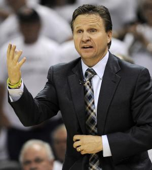 Oklahoma City Thunder head coach Scott Brooks makes a call from the sideline against the San Antonio Spurs during the second half of Game 5 in the NBA basketball Western Conference finals, Monday, June 4, 2012, in San Antonio. (AP Photo/Darren Abate)