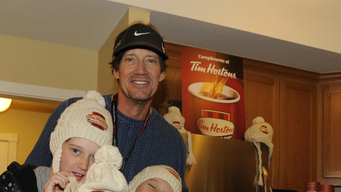 Actor Kevin Sorbo and his children visit Tom Hortons cafe & bake shop coffee bar at the Fender Music lodge during the Sundance Film Festival on Saturday, Jan. 19, 2013, in Park City, Utah. (Photo by Jack Dempsey/Invision for Fender/AP Images)