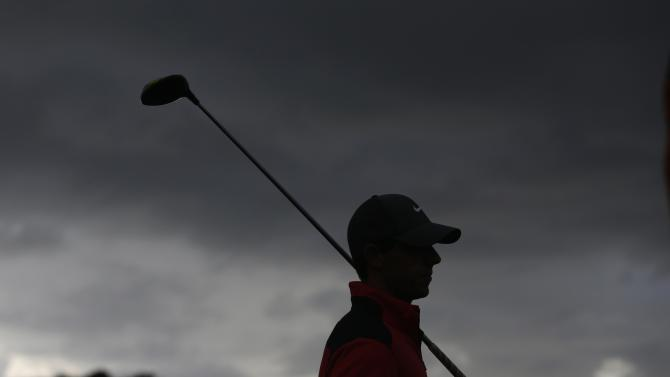 Northern Ireland's McIlroy prepares to tee off from the 10th hole during the first round of the Australian Open golf tournament in Sydney