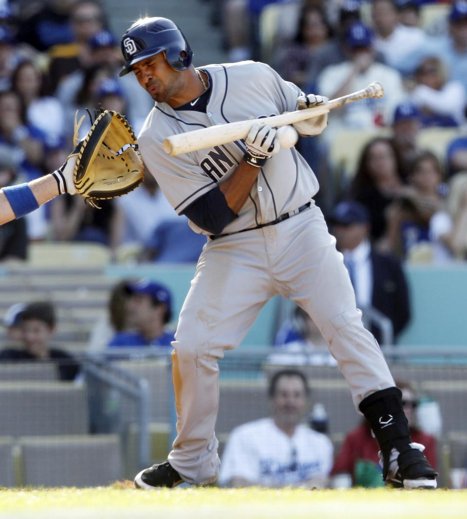 San Diego Padres' Jesus Guzman grounds into a controversial triple play by the Los Angeles Dodgers in the ninth inning of a baseball game in Los Angeles Sunday, April 15, 2012. The Dodgers won 5-4. (AP Photo/Reed Saxon)