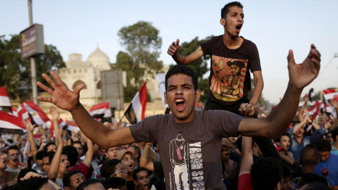 """Opponents of Egypt's Islamist President Mohammed Morsi chant slogans during a protest outside the presidential palace, in Cairo, Egypt, Monday, July 1, 2013. Egypt's military on Monday issued a 48-hour ultimatum to the Islamist president and his opponents to reach an agreement to """"meet the people's demands"""" or it will intervene to put forward a political road map for the country and ensure it is carried out. (AP Photo/Hassan Ammar)"""