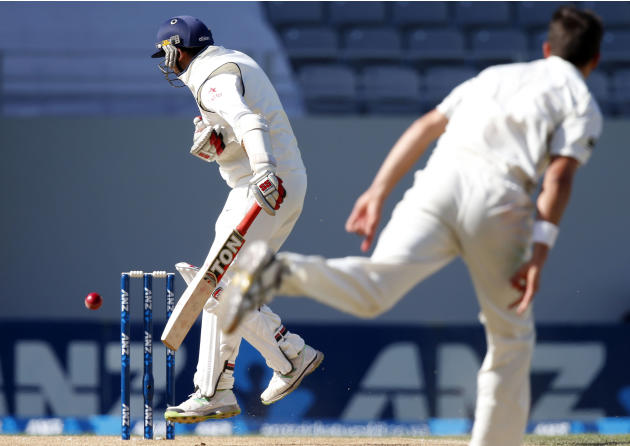 India's Khan misses the ball from New Zealand's Southee during his second innings on day four of the first international test cricket match at Eden Park in Auckland
