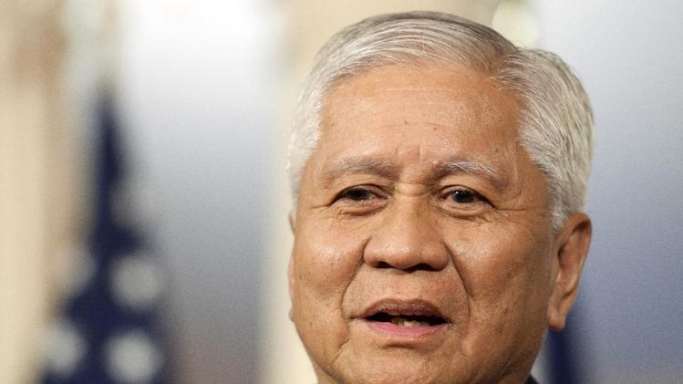 Philippine Foreign Secretary Albert del Rosario speaks with reporters before a meeting with Secretary of State John Kerry at the State Department in Washington, Tuesday, April 2, 2013. (AP Photo/Cliff Owen)