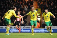 El Norwich City derrot 2-1 como anfitrin del Sunderland (17) y se coloc 12 de la tabla de clasificacin de la Premier League del ftbol ingls, que Lidera el Manchester United, que se impuso el sbado por 4-3 en el campo del Reading (19 y penltimo). (AFP | olly greenwood)