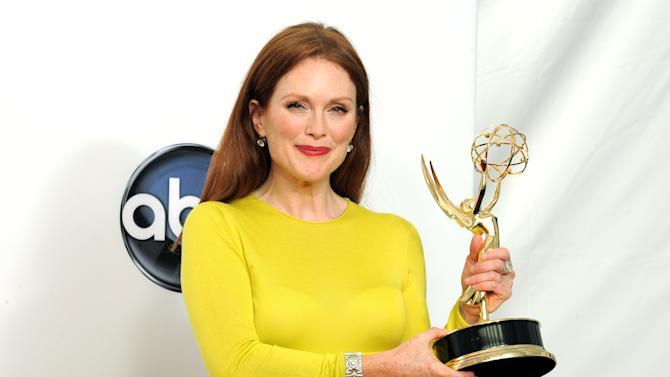 "Actress Julianne Moore, winner  of the Outstanding Lead Actress In A Miniseries or Movie for ""Game Change"", poses backstage at the 64th Primetime Emmy Awards at the Nokia Theatre on Sunday, Sept. 23, 2012, in Los Angeles. (Photo by Jordan Strauss/Invision/AP)"