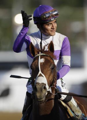 Jockey Mario Gutierrez, aboard I'll Have Another, waves to the crowd after winning the 137th Preakness Stakes horse race at Pimlico Race Course, Saturday, May 19, 2012, in Baltimore. (AP Photo/Patrick Semansky)