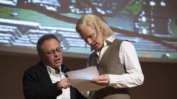 "This image released by Dreamworks Pictures shows director Bill Condon, left, with actor Benedict Cumberbatch on the set of ""The Fifth Estate."" (AP Photo/Dreamworks Pictures, Frank Connor)"