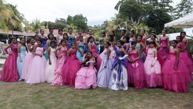 """Female cancer patients pose for a group photo during their """"Quinceanera"""" (15th birthday) party at a hotel in Managua"""