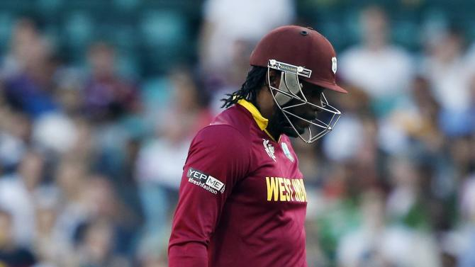 West Indies batsman Chris Gayle reacts as he walks off the field after being bowled for three runs by South Africa's Kyle Abbott during their Cricket World Cup match at the SCG