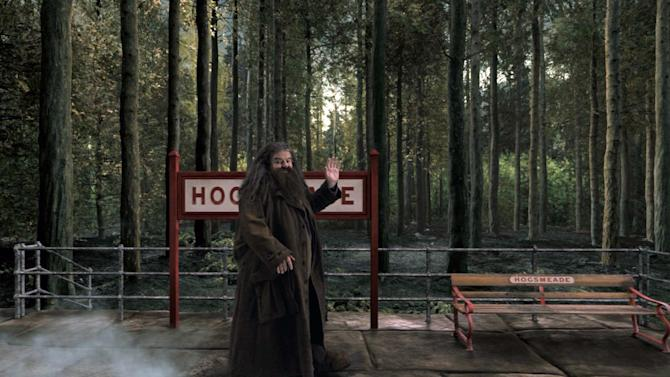 "CORRECTS TO HARRY POTTER - This image released by Universal Orlando shows the character Hagrid from the ""Harry Potter"" book and film series in a scene from the Hogwarts Express attraction that will debut this summer at Universal Orlando. The attraction will allow fans to ride the Hogwarts Express train and experience the British countryside just as the characters did in the book and movie series. (AP Photo/Universal Orlando)"
