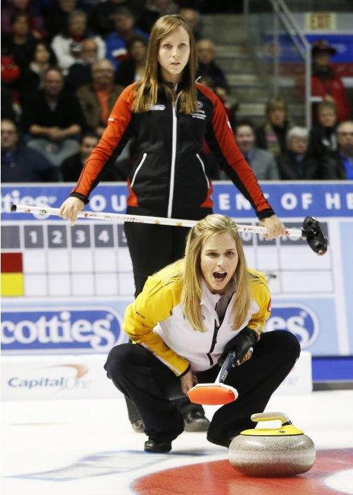 Manitoba skip Jones calls a shot in front of Ontario skip Homan during their gold medal game at the Scotties Tournament of Hearts curling championship in Kingston