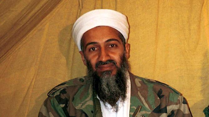 This undated file photo shows al Qaida leader Osama bin Laden, in Afghanistan. A firsthand account of the Navy SEAL raid that killed Osama bin Laden contradicts previous accounts by administration officials, raising questions as to whether the terror mastermind presented a clear threat when SEALs first fired upon him.  (AP Photo)