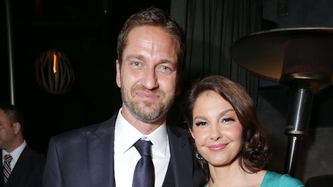 Gerard Butler and Ashley Judd at FilmDistrict's Premiere of 'Olympus Has Fallen' hosted by Brioni and Grey Goose at the ArcLight Hollywood, on Monday, March, 18, 2013 in Los Angeles. (Photo by Eric Charbonneau/Invision for FilmDistrict/AP Images)