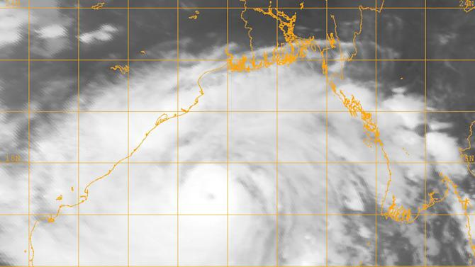 """This image provided by the U.S. Naval Research Lab shows Indian Cyclone Phailin taken Friday Oct. 11, 2013 at 6:32 a.m. EDT (10:32 GMT). Officials ordered tens of thousands of coastal villagers to flee their homes Friday as a massive cyclone _ so large it filled nearly the entire Bay of Bengal _ gathered strength and headed toward India's eastern seaboard. The Indian Meteorological Department warned that Phailin was a """"very severe cyclonic storm"""" that was expected to hit with maximum sustained winds of 210-220 kilometers (130-135 miles) per hour. Forecasters are saying Cyclone Phailin will hit the region Saturday evening. (AP Photo/Naval Research Lab)"""