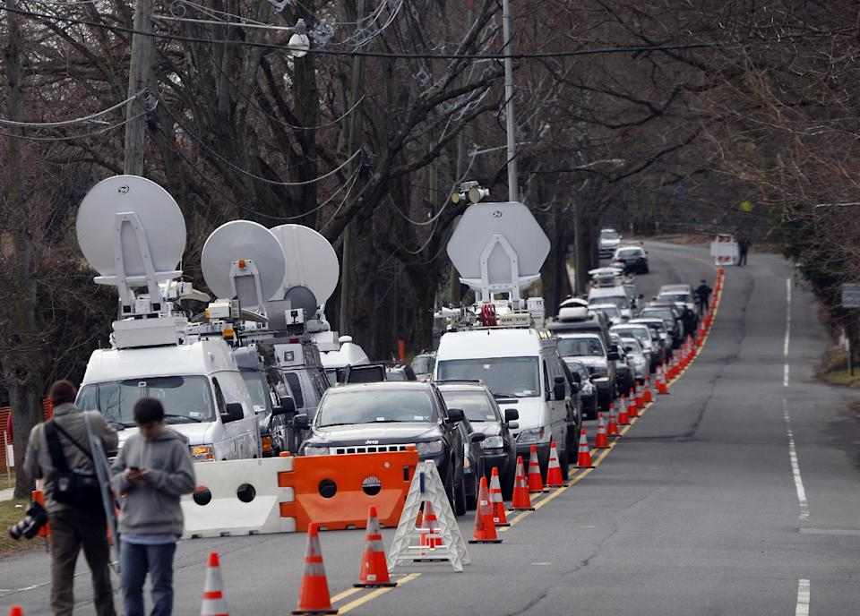 A long line of media vehicles line up to cover the burial of Whitney Houston at Fairview Cemetery for her burial in Westfield, N.J., Sunday, Feb. 19, 2012. (AP Photo/Rich Schultz)