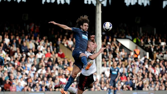 Fulham's Pajtim Kasami, right, competes for the ball with Newcastle United's Fabricio Coloccini during the English Premier League soccer match between Fulham and Newcastle United at Craven Cottage stadium in London, Saturday, March 15, 2014