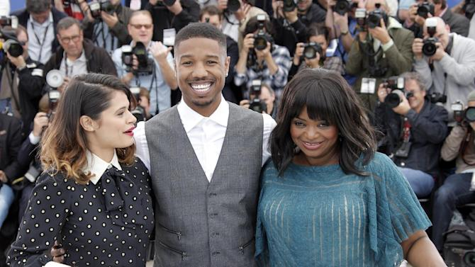 """FOR STORY FRANCE CANNES MICHAEL B JORDAN -  A photo call for the film Fruitvale Station, with actors from left,  Melonie Diaz, Michael B. Jordan and Octavia Spencer as they pose for photographers during at the 66th international film festival, in Cannes, southern France, Thursday, May 16, 2013. """"Fruitvale Station"""" has received rave reviews at Cannes, and its power owes much to Jordan's performance, according to reviewers. (AP Photo/Francois Mori)"""