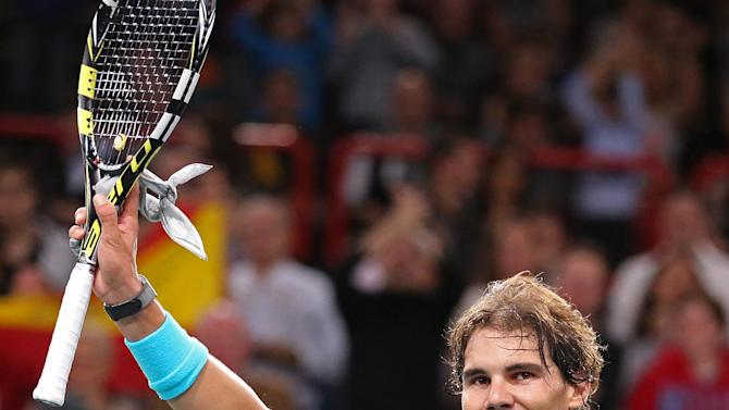 Spain's Rafael Nadal acknowledges applause after defeating France's Richard Gasquet during their quarterfinal match, at the Paris Masters tennis, in the Paris Bercy stadium, Friday Nov.1, 2013.(AP Photo/Remy de la Mauviniere)