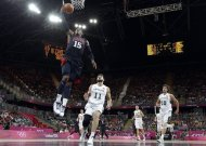 USA's Carmelo Anthony (15) scores against Lithuania's Linas Kleiza during a preliminary men's basketball game at the 2012 Summer Olympics, Saturday, Aug. 4, 2012, in London. (AP Photo/Eric Gay)