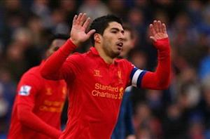 Forlan says Suarez signing would make Arsenal title contenders again