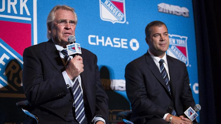 Glen Sather, left, president and general manager of the New York Rangers, speaks alongside newly announced head hockey coach Alain Vigneault at Radio City Music Hall, Friday, June 21, 2013, in New York. Vigneault, 52, comes to the Rangers after seven years as coach of the Vancouver Canucks. (AP Photo/John Minchillo)