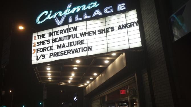 """Cinema displays """"The Interview"""", which starts screening tomorrow, on the marquee near Union Square on Christmas eve in the Manhattan borough of New York"""