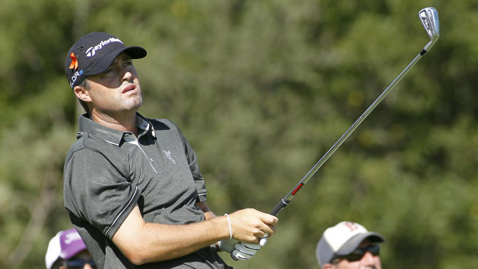 Ryan Palmer watches his tee shot on the third hole during the first round of the Deutsche Bank Championship golf tournament in Norton, Mass., Friday, Aug. 29, 2014. (AP Photo/Stew Milne)