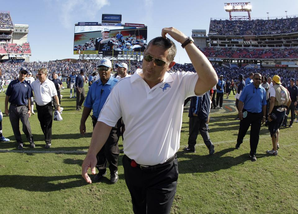 Detroit Lions head coach Jim Schwartz leaves the field after the Lions lost to the Tennessee Titans 44-41 in overtime at an NFL football game on Sunday, Sept. 23, 2012, in Nashville, Tenn. (AP Photo/Wade Payne)