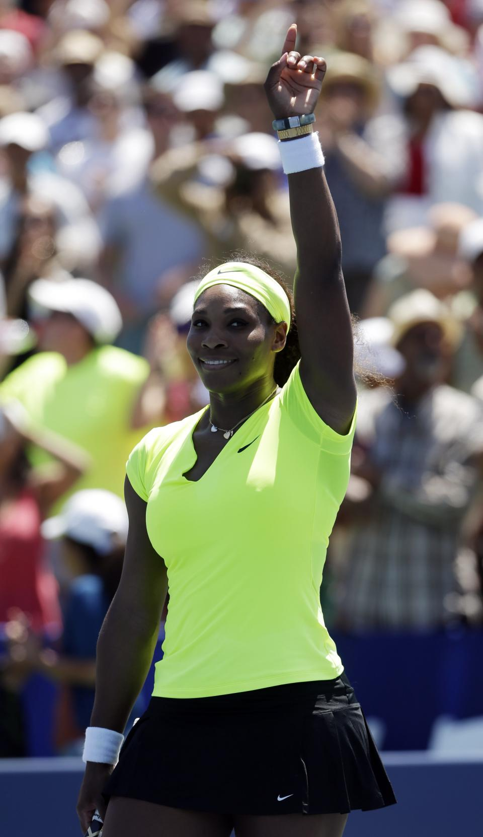 Serena Williams, of the United States, celebrates after defeating Coco Vandeweghe, of the United States, during the final of the Bank of the West tennis tournament on Sunday, July 15, 2012, in Stanford, Calif.  Williams won 7-5, 6-3. (AP Photo/Marcio Jose Sanchez)
