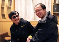 Outspoken government critic Hu Jia (right) with Chen Guangcheng at an undisclosed location in Beijing after the blind lawyer&#39;s escape. Hu has been detained in the latest in a string of moves by Chinese security forces against people linked to activist Chen, reportedly under US &quot;protection&quot;