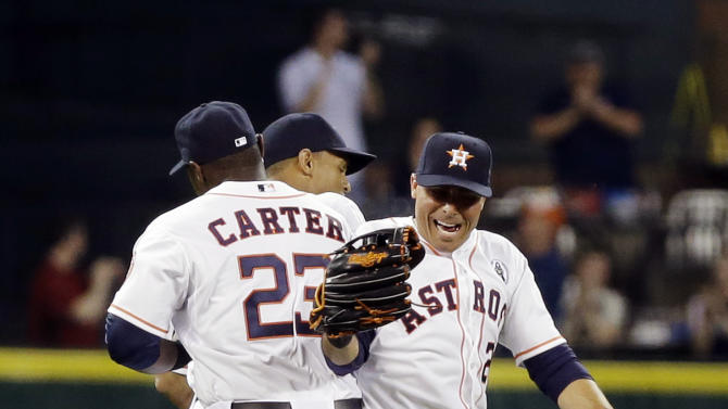 Houston Astros' Chris Carter (23), Justin Maxwell, center, and Rick Ankiel celebrate their 8-2 win over the Texas Rangers in a season-opening baseball game, Sunday, March 31, 2013, in Houston. The Astros earned their 4,000th regular-season win in franchise history. (AP Photo/Pat Sullivan)