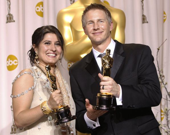 "Sharmeen Obaid-Chinoy, left, and Daniel Junge pose with their awards for best documentary short for ""Saving Face"" during the 84th Academy Awards on Sunday, Feb. 26, 2012, in the Hollywood section of Los Angeles. (AP Photo/Joel Ryan)"