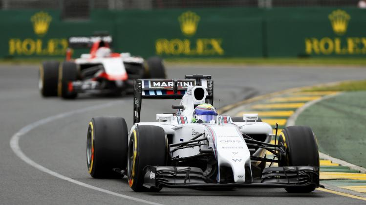 Williams Formula One driver Massa of Brazil drives ahead of Marussia Formula One driver Bianchi of France during the qualifying session for the Australian F1 Grand Prix in Melbourne