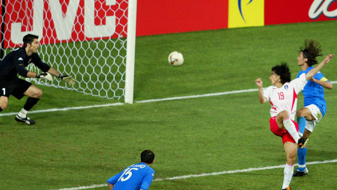 FILE - In this Tuesday June 18, 2002 file photo, South Korea's Ahn Jung Hwan, second from right, scores the winning goal against Italy in their Soccer World Cup second round match, at Daejeon World Cup stadium, in Daejeon, South Korea. Italy's Paolo Maldini at right, as Mark Iuliano, foreground and goalkeeper Gianluigi Buffon look on. On this day: Italy loses the round of sixteen match against the co-hosts South Korea 2-1. (AP Photo/Greg Baker, File)