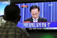 A man watches a television screen as South Korea's President Lee Myung-Bak delivers an apology to the nation through a live broadcast at a railway station in Seoul. Lee apologised for what he called heartbreaking corruption cases allegedly involving his elder brother and close aides