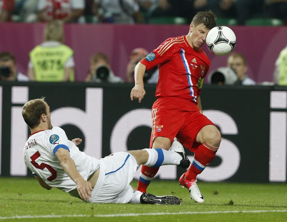 Russia's Andrei Arshavin, right, is tackled by Czech Republic's Roman Hubnik during the Euro 2012, Group A soccer match between Russia and Czech Republic, in Wroclaw, Poland, Friday, June 8, 2012.  (AP Photo/Petr David Josek)