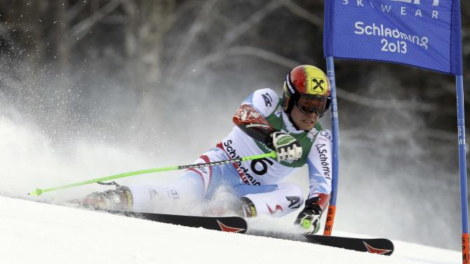 Austria's Marcel Hirscher passes a gate during the first run of the men's giant slalom at the Alpine skiing world championships in Schladming, Austria, Friday, Feb.15, 2013. (AP Photo/Luca Bruno)