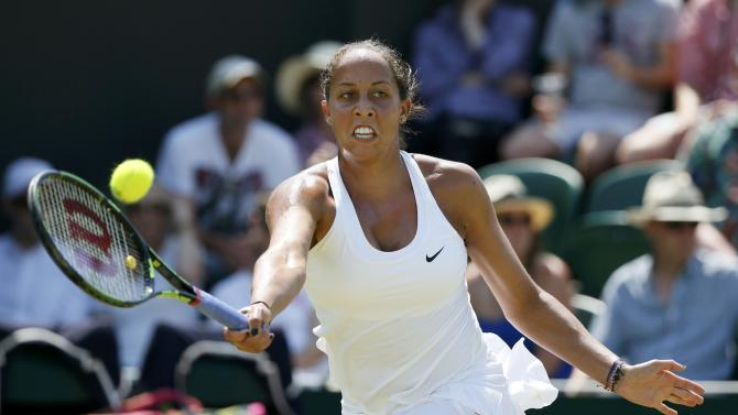 Madison Keys of the U.S.A. hits a shot during her match against Stefanie Voegele of Switzerland at the Wimbledon Tennis Championships in London