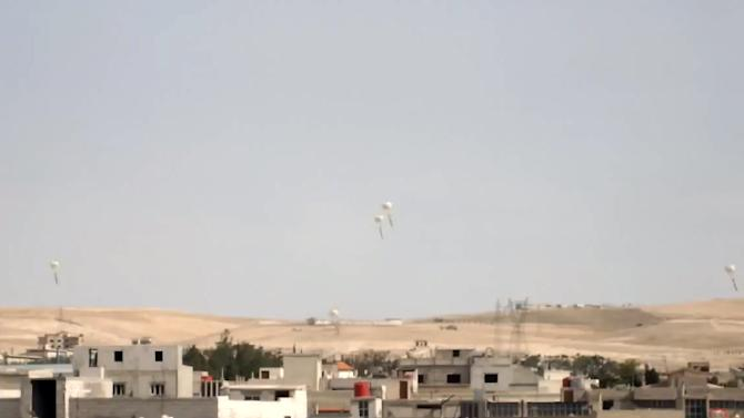 In this image taken from video obtained from the Shaam News Network, which has been authenticated based on its contents and other AP reporting, explosives are dropped by a Syrian government warplane in Yabroud near Damascus, Syria, Monday May 20, 2013. The Syrian regime claims there is no civil war in the country but that the army is fighting foreign-backed terrorists trying to topple Assad's government. More than 70,000 people have been killed in Syria since March 2011. (AP Photo/Shaam News Network via AP video)